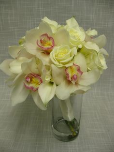 Wedding Bouquet of white cymbidium orchids, escimo roses and white mini calla lilies