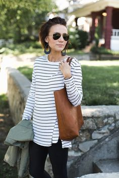 Stripes for life. Love the leather accessories here with the military jacket.