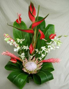 Akala Hula 'Pink Dance' Hawaiian flower assortment.  Heliconia, king protea, pink ginger and orchids.  12 Stems