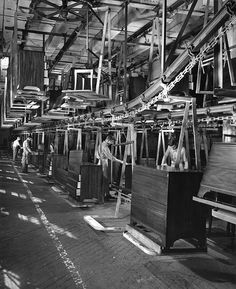 Caption: This 2 1/2 mile long conveyor carries furniture through the air-conditioned finishing rooms of the Mengel Furniture Company plant in Louisville, Kentucky. Modern furniture making is a production line proposition.    Date: [no date]    Photograph