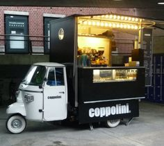 Coppolini Piaggio Ape espresso truck, Stäfa, Switzerland. Classy little fit out. Love the lights and built-in glass display cabinet.