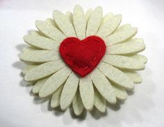 Adorable off-white felt flower with red heart center just in time for Valentine's Day    Size:  3 1/4 inches in diameter    1 3/4 inch alligator clip with non slip grip    This flower doesn't necessarily have to be worn in the hair. Clipping it to a purse would be so cute!    http://www.etsy.com/listing/90907349/felt-heart-hair-flower-hair-clip