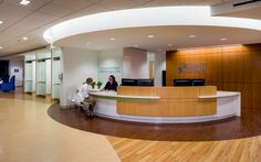 University of Virginia Battle Building Interior Architecture by Stanley Beaman & Sears Reception Counter Design, Curved Reception Desk, Medical Design, Healthcare Design, Healthcare Architecture, Interior Architecture, Hospital Reception, Waiting Room Design, Medical Office Decor