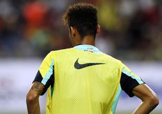 Neymar of Barcelona FC takes a break during Barcelona FC training session at Bukit Jalil National Stadium on August 9, 2013 in Kuala Lumpur, Malaysia.
