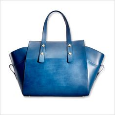 A brilliant blue #fabfound handbag featured on In Style has duo wings for extra room to fit laptops, books and more.