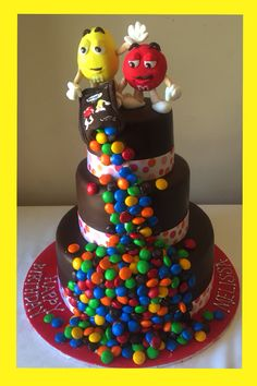 M&M M&Ms three tiered chocolate cake with red and yellow M&m's figures figurines