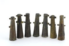 A selection of the 25 copper alloy bandoleer bottles found in the Alderney…