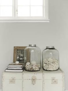 the trunk as a tabletop is always great, and the large glass jars are filled with unexpected, monochromatic materials has a cool effect