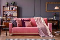 Pink velvet couch with decorative pillows standing in grey living room interior with vintage cupboard, fresh plants and molding on the wall living room interior royalty free stock images stock photo Decor, Pink Velvet Sofa, Decorating Your Home, Decorative Pillows Couch, Purple Decor, Luxury Living Room, Sofa, Design Color Trends, Satin Pillow