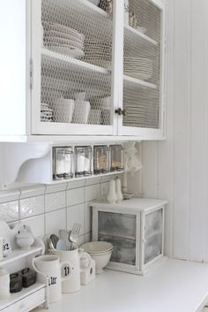 Shabby Chic Kitchen...love the wire on the cabinets