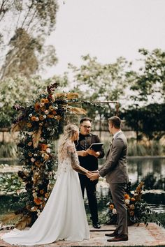 Lakeside boho wedding ceremony with flower covered arch backdrop   Image by Lukas Korynta Bohemian Wedding Inspiration, Boho Wedding, Wedding Blog, Wedding Styles, Wedding Ceremony, Orange Wedding Colors, Fall Color Palette, Vows, Arch