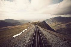"""You're waiting for a train, a train that will take you far away. You know where you hope this train will take you, but you don't know for sure. But it doesn't matter. ""    Llanberis, Wales, UK"