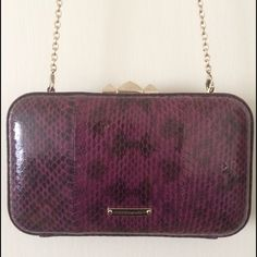 Rebecca Minkoff snake print clutch + minaudiere This Rebecca Minkoff is a purple/luxe leather snake print shoulder bag / clutch combo with her signature purple polka dot lining series. I'm making it super affordable because there's a small nick on the front that's an easy fix for your shoe guy. ✅ I am open to reasonable offers. Rebecca Minkoff Bags