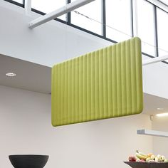 BuzziSpace has developed the BuzziLoose in sound-insulating felt: stick it to the ceiling to dampen sounds without losing out on chic design.