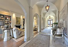 LHM Dallas/Ft. Worth - Stunning Mediterranean style residence in Old Highland Park! A stucco exterior, clay tile roof and cast stone columns amidst Palladian arches properly introduce this home, foreshadowing the sophisticated style within! Lush landscapes and a balcony with stone balustrades complete the elevation. The central corridor accentuated with limestone floors, curved arches, pendant lighting and French doors serves as the axis to all living areas on the first floor...