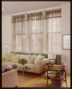 Replace heavy curtains with lighter weight ones.  Before storing your heavy window treatments, be sure to clean them properly.