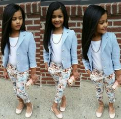 Girls pretty outfit with light blue blazer and floral pants