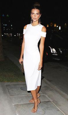 On Emily Ratajkowski: Alice and Olivia Meya Fitted Dress ($275); Stuart Weitzman Nudist Sandals ($398).