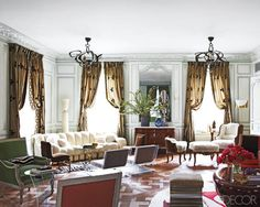 Francophile Fantasy in New York-In the living room, a sofa by Ueli Berger is flanked by a pair of Eugene Printz chairs and faces a pair of 1970s French Plexiglas chairs; the bronze light fixtures are by Hervé Van der Straeten, the mahogany cabinet is Louis XVI, and a Philippe Hiquily floor lamp stands behind a 1740s Louis XV duchesse en bateau.