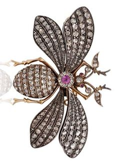 AN ANTIQUE DIAMOND BEE BROOCH  Set with rose-cut diamonds, enhanced by a circular-cut ruby and ruby eyes, mounted in silver and low karat gold, circa 1860's, in a red leather case signed Wartski