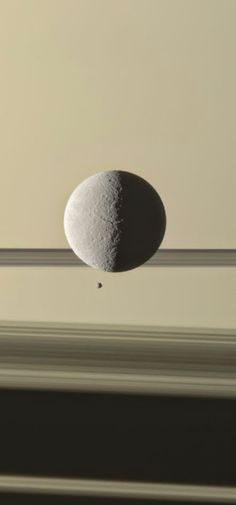 New Cassini Image: Saturn& moon Rhea with the planet& tiny moon Epimetheus Credit: NASA/JPL-Caltech/Space Science Institute; Processed image: G. Cosmos, Space Photos, Space Images, Interstellar, Planets And Moons, Moons Of Saturn, Nasa Moon, Saturn Planet, Saturns Moons