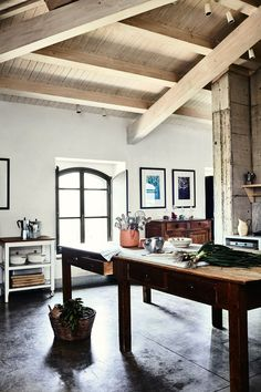 """The dining area is on the ground floor with the living area and kitchen. Some of the rooms here are laid with original lava blocks, and much of the furniture is antique and vintage pieces found in flea markets in Italy, France and Belgium.  [b][i]You may also like: [link url=""""http://www.houseandgarden.co.uk/interiors/dining-room""""]Dining Room Ideas[/link][/i][/b]"""