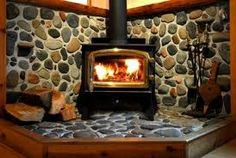 Home Interior Ideas River rock wood stove hearth. We are doing this project now:) Wood Stove Decor, Wood Stove Wall, Corner Wood Stove, Wood Stove Surround, Wood Stove Hearth, Stove Fireplace, Wood Burner, Cozy Fireplace, Fireplace Ideas