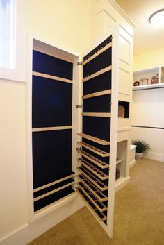Jewelry storage hidden in millwork - love this idea and may use in our upcoming home build!