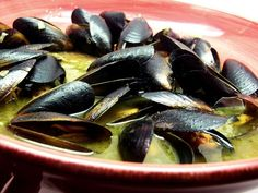 Mussels cooked in a white wine garlic-butter sauce served with sliced crusty bread for dipping. My husband's favorite meal for two!