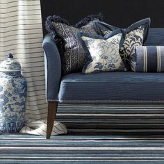 Barclay Butera is another designer big on blue and white, and mixing it with a British Colonial look.