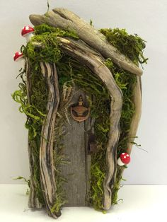 This is a handmade Gnome or Fairy Door made out of recycled wood each one is very unique and true conversation piece for inside your home as an