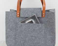 Grey felt tote bag, with crochet applique, for shopping, genuine leather handles, gray tote bag, tote felt with crochet application.  This bag is a simple design but, at the same time very stylish. The size is ideal for carrying magazines, books, notebook or files. Fresh, elegant, casual and much more.  Made of gray felt. Felt is impregnated 4mm (0,16). With grey crochet application.Inside large pocket. Straps are 2 cm (0,79) wide, 72cm (28,35) long Dimension approximately :42 cm (16,5)…