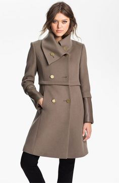 Taupe wool coat with leather cuff detail.
