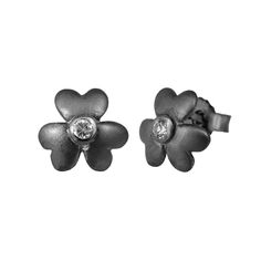 Small flower sterling silver ear studs from Svane & Lührs with white sparkling CZ. // Worldwide shipping EUR 5 //