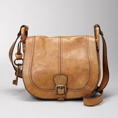 """Fossil Vintage re-issue magnet flap leather crossbody in brown. Featuring cell phone and PDA pockets, has no exterior pockets (11"""" length x 3 1/2"""" width x 9"""" height, 20"""" total shoulder strap length). $148.00 #crossbody_bag #brown #fossil"""
