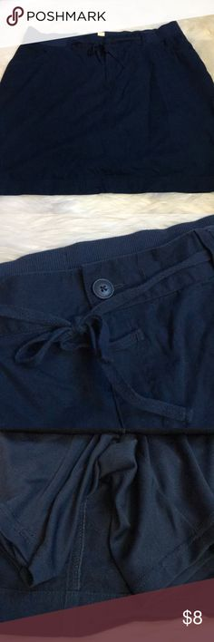 Cj banks navy skort Skirt with built in shorts. Size 2x. Good used condition. Buttons and zips in the front with a drawstring tie. Pockets. CJ Banks Skirts