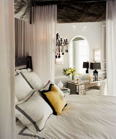 Bedrooms that aim for Hollywood Regency style need to embrace luxurious fabric!