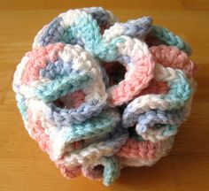 How to Crochet a Bath Puff - wikiHow Would make a good gift.