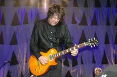 The late Gary Moore with one of his Gibson Les Paul guitars.