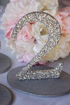 Glitter Wedding Table Numbers - in gold please and love the flowers behind it