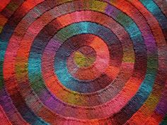 a rainbow knitted rug