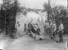 A 60 pounder gun of the Royal Garrison Artillery in action. Dainville, 12th May 1916. ©IWM
