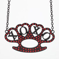 """Black heart shaped brass knuckles with red diamond bling reading """"XOXO"""" in center on a black chain with lobster clasp."""