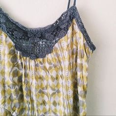 Kimchi Blue | white/grey/yellow top Kimchi Blue white/grey/yellow spaghetti strap top with beautiful floral grey embroidered lace detail and cute unique pattern. Great under a cardigan or by itself - very versatile! Good condition - lightly used. Urban Outfitters Tops Tank Tops