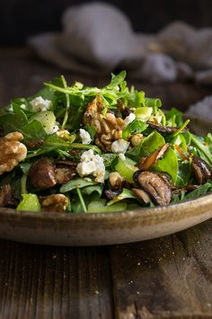 Mushroom and arugula salad with goat cheese, toasted walnuts, and celery - tossed in shallot mustard and truffle oil vinaigrette, this salad is bursting with earthy, fall flavors.