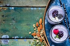 #Healthy berry smoothie  Berry smoothie with pumpkin and chia seeds in glass jars on old rusty iron background over rustic wood table selective focus. Detox Diet Well being and weight loss concept