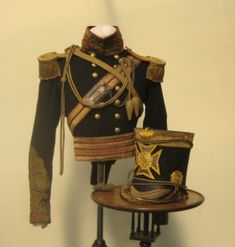 "A 4th or Queens Own Light Dragoon Officers Uniform and Shako circa 1850    An exceptionally rare and possible uniigue example of a ""Charge of the Light Brigade"" period officer`s uniform and Albert shako to the 4th or Queens Liight Dragoons."