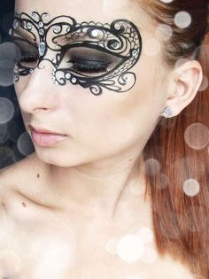 A sensual photo of a pretty woman in extreme makeup, transforming and magnifying her natural beauty into something both more striking and, in the end, more beautiful, for it is the product of human creativity. A simple, lacey mask can make a dramatic impact.