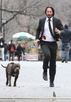 2015 December 22nd. 51-year-old actor's crisp white shirt was splattered with blood. Keanu Reeves filming action scenes for sequel John Wick 2 in NYC. dailymail.co.uk 51-year-old actor's crisp white shirt was splattered with blood including a patch which indicated he may have suffered a gun-shot wound.