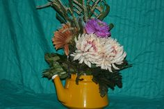silk arrangement in a vintage container selling for $140.00